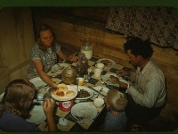 The Faro Caudill [family] eating dinner in their dugout, Pie Town, New Mexico  (LOC)